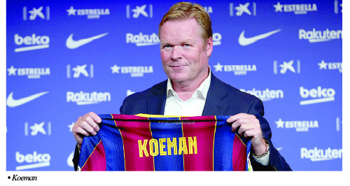Amuneke backs Koeman to lift Barca
