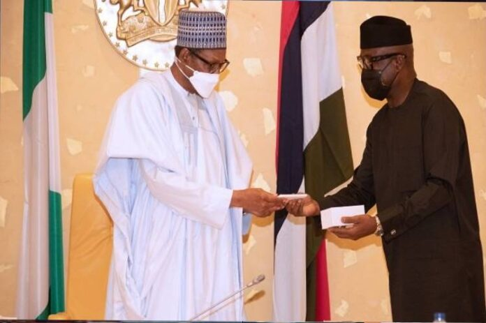President Buhari receives first made in Nigeria mobile phone at FEC, swears in two federal commissioners